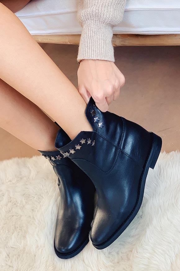 Ovyé - Ankle boots with black stars and inner wedge in real leather