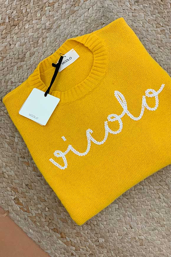 Yellow ocher sweater with white embroidery